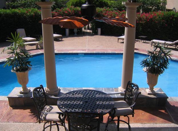 About Vineyard Court Designer Suites Hotel
