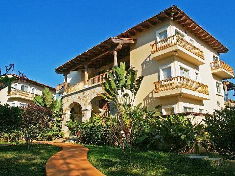Marina puesta del sol resort el cubano compare deals for Edificio puesta del sol