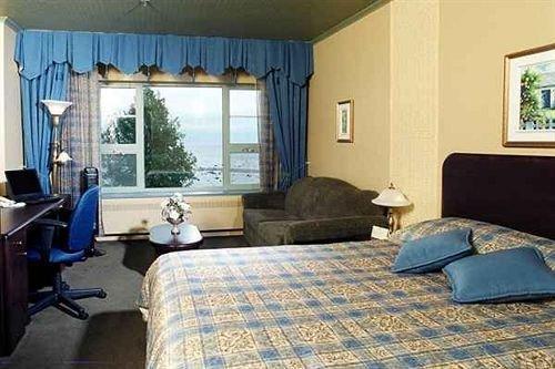 Le manoir baie comeau compare deals - Chambre a coucher noir et gris ...