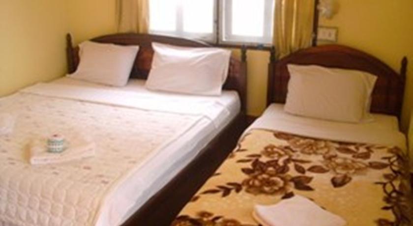 Vang vieng orchid guesthouse vang vieng laos for Domon guesthouse vang vieng