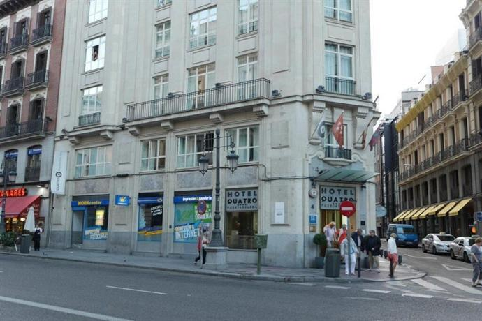 Hotel quatro puerta del sol madrid compare deals for Puerta del so
