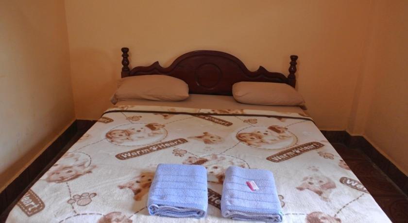 Souankhamphone guesthouse vang vieng compare deals for Domon guesthouse vang vieng