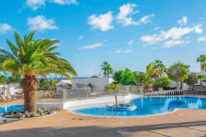 Jardines del sol by diamond resorts playa blanca for Jardines del sol
